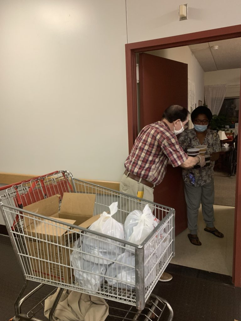 Juan delivering the meals to elderly residents in his building - 2