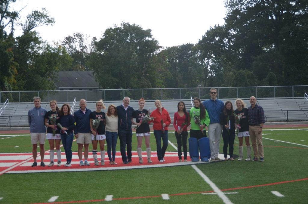 (PHOTO: Rye Girls Varsity Field Hockey seniors with family members for senior day.)