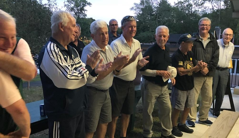 (PHOTO: Rye Veterans leading the audience of 150 in the Pledge of Allegiance. Left to Right: Hank Birdsall, Charlie Rosabella, Tim Moynihan Tom Bassista, Vinnie Ballantoni, Jim Dianni, Frank Harrigan.)